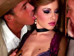 Glamorous babe Dona Bell is sucking two dicks in the hayloft