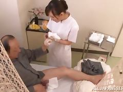 Japanese nurse gives a handjob and rides a dick