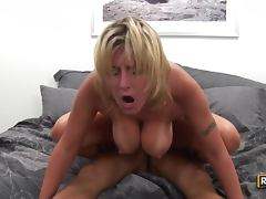 Playful blonde girl with huge natural tits rides a dick