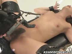 Asian babe gets tied up and fucked by a machine