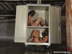 Betty Baphomet and Bobbi Blair have some fun in wet BDSM scene