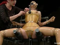 Girl in latex gets some pain in an arched pose porn video