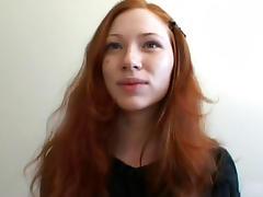 Slim redhead babe Millena demonstrates her puss