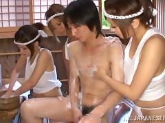 Three Japanese girls have sex with a guy in a sauna