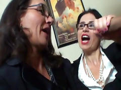 Two cock-sucking office babes are giving blowjob