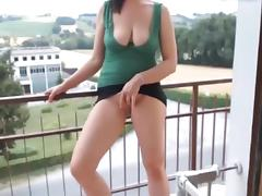 Girl stripping on balcony, nice