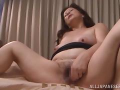 Japanese milf Chizuru Iwasak enjoys fingering her meaty cunt indoors