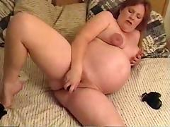 Pregnant mom enjoys toying her hairy cunt in a homemade clip