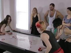 Girls play air hockey and strip