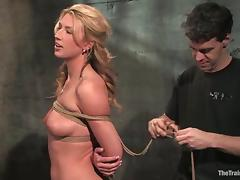 Pretty blonde gets tied up and enjoys a dildo in her ass