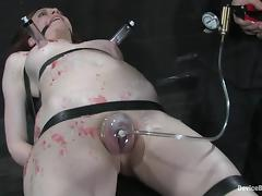 Natalie Minx enjoys having hot wax on her body and a dildo in her cunt