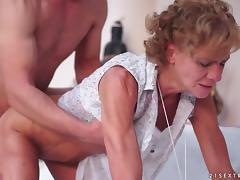 Granny makes out with a horny stud before taking his dick in her cunt