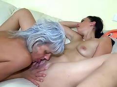 Mature lesbian eats brunette's shaved pussy