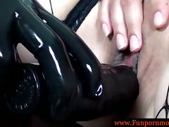 Latex lesbians rub and dildo their pussies