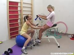 Teen lesbians toy twats in gym