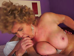 Curly-haired granny with nice face suck a dick