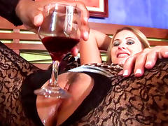 Glamorous blonde sucks a big black cock after having whine