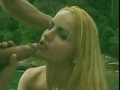 Blonde shemale fucks hard and gets a facial on boat