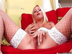 Sexy blonde slut gets horny showing off porn video