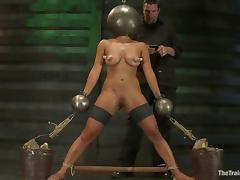 A huge iron ball is worn on Adrianna Luna's head porn video