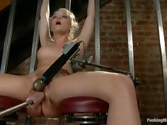 Alexis Texas moans in delight while being fucked by a sex machine