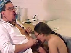 Sweet brunette is sucking doctor's cock