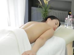 Sexy brunette deepthroats a cock and gets fucked in a massage parlour