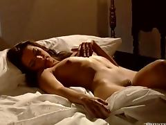 Vanda fingers her smooth pussy before pounding it with a dildo
