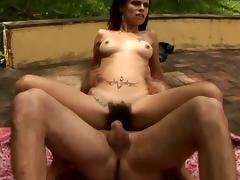 Slim Leslie gets her hairy pussy rammed outdoors