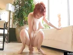 Readhead fills her creaming pussy with a toy
