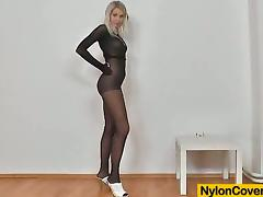 Lovely pretty good babe in nylon bodysuit toys her vagina