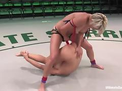 Blond wrestler is fucking her opponent with a huge strapon
