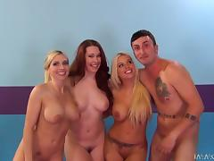Three smoking hot chicks surround this man