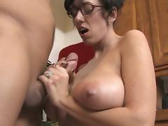 Busty milf strokes big fat cock