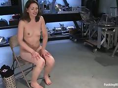 Sarah Shevon demonstrates a proper usage of a machine