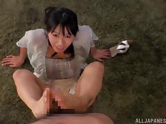 Japanese hussy Hana Haruna gives a handjob and a footjob to some dude