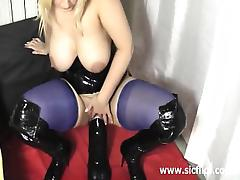 Crazy milf fucks a titanic dildo in both her holes