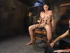 Krissy Kage gets her cunt whipped and fucked with a wired dildo
