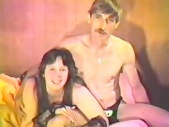 Chubby brunette milf sucks her man's dick in a vintage video porn video