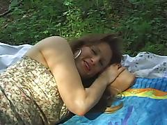 Mature couple are having sex in the park