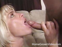 Slutty MILF with fake tits sucks a dick in POV video