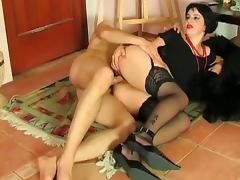 Retro dressed brunette eats cock and does hardcore anal