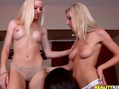 Two blondes and a brunette use a dildo while making lesbian love