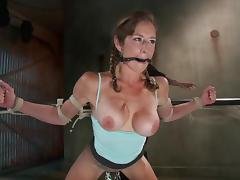 Busty angel is facing a severe device bondage