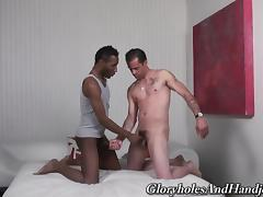 Two homosexuals are wanking each other's penises