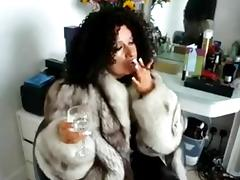 Fur mistress in boots and latex smoking porn video