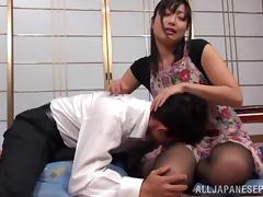 Mature Asian housewife Emiko Ejima gives dominating footjob