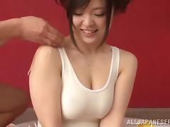 Japanese Hottie in a Wet T-shirt Gives a Handjob porn video