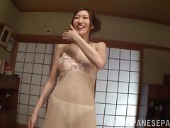 Oiled up Japanese MILF gives an erotic massage and a footjob