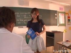 Japanese teacher shows her cock-sucking skills to a few college boys